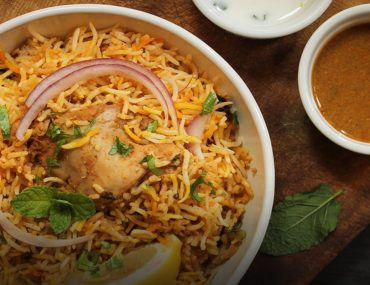 Chicken biryani in Abu Dhabi with tamarind chatney