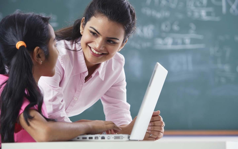 teacher guiding a student