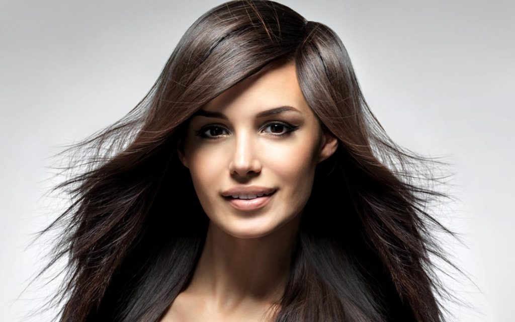 Brunette with healthy and shiny hair