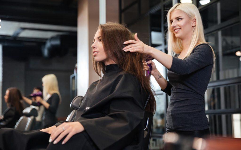Hair stylist treating her client's hair