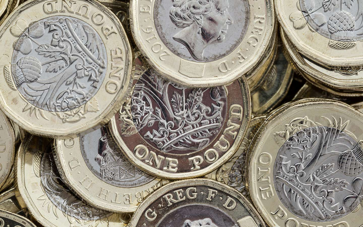 One British Pound coins scattered