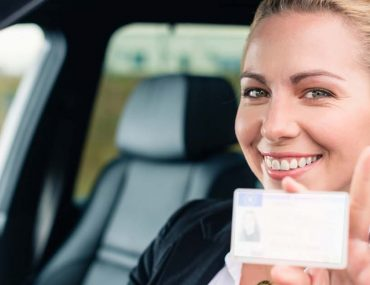 woman holding driving license