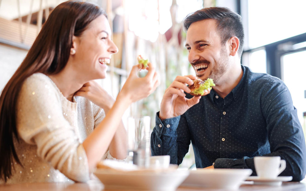 Couple laughing while having best brunch in Fujairah