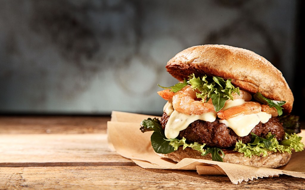 a plate of shrimp burger at one of the top burger restaurants in Sharjah