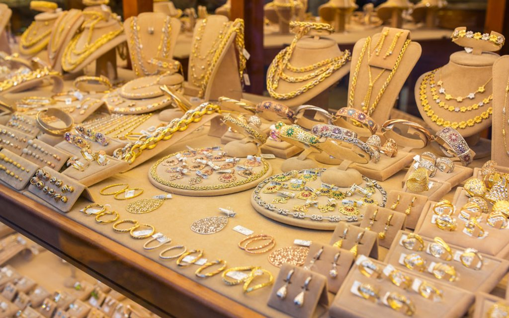 rings, pendants, necklaces and earrings on display in a gold shop