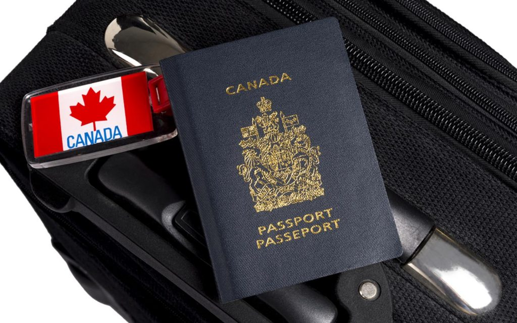 Canadian passport on suitcase