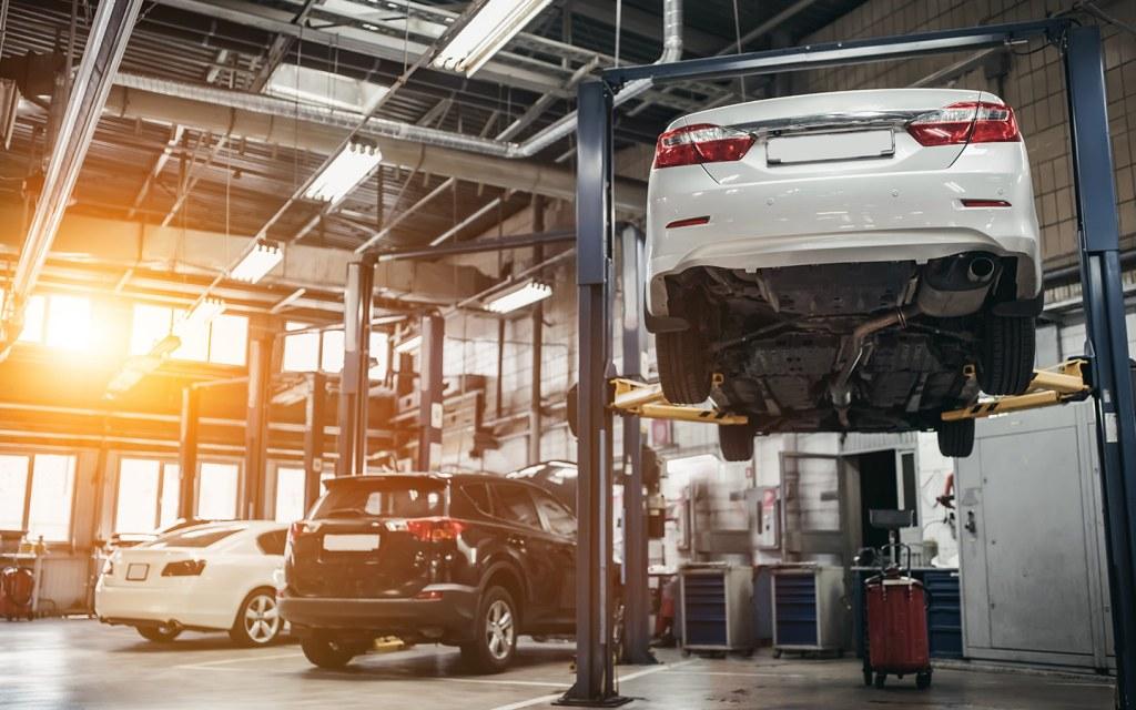 A car is lifted for repair at a car service centre in Dubai