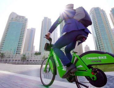 man riding careem bike in Dubai