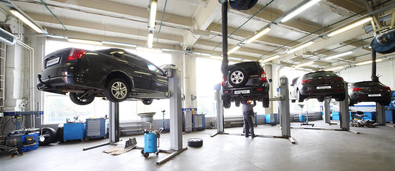 Cars lifted in a car repair garage dubai
