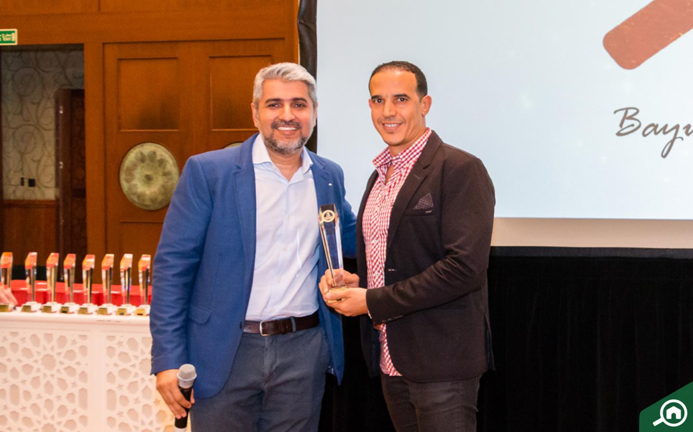 Casa Nostra Real Estate Brokers receiving the Golden Circle award at the Bayut Iftar