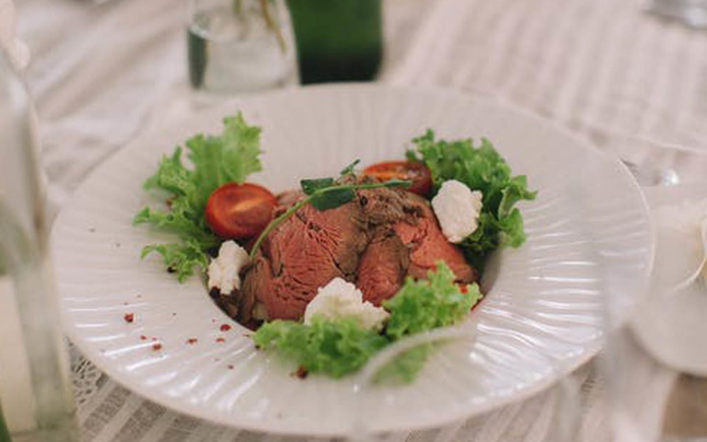 Fresh steak prepared by chefs at the top catering companies in Abu Dhabi
