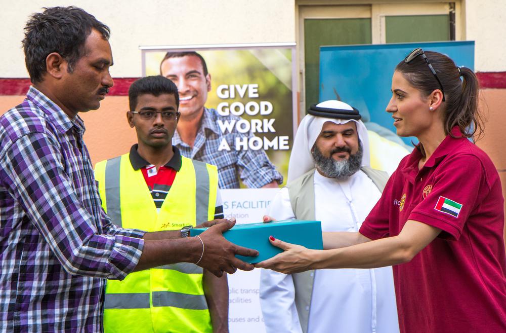 Woman giving charity in Ramadan in Dubai