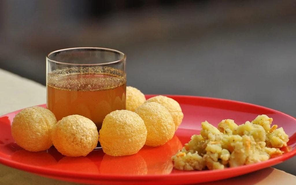 Plate of pani puri with sauce