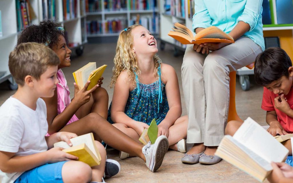 kids are having fun time at a library