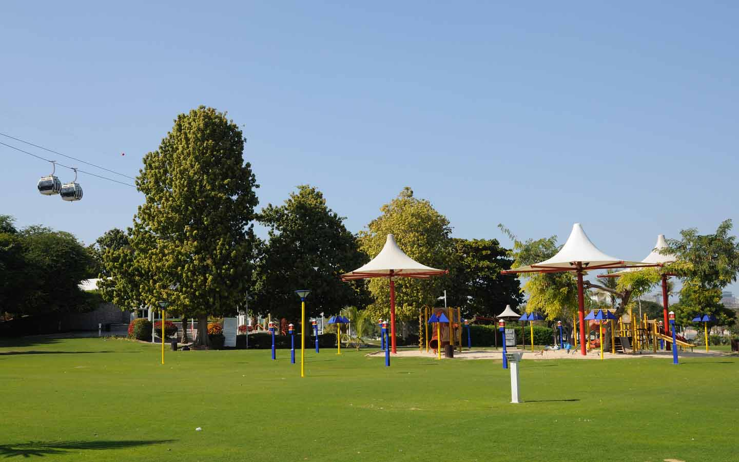 Swings at kids play area in Dubai Creek Park