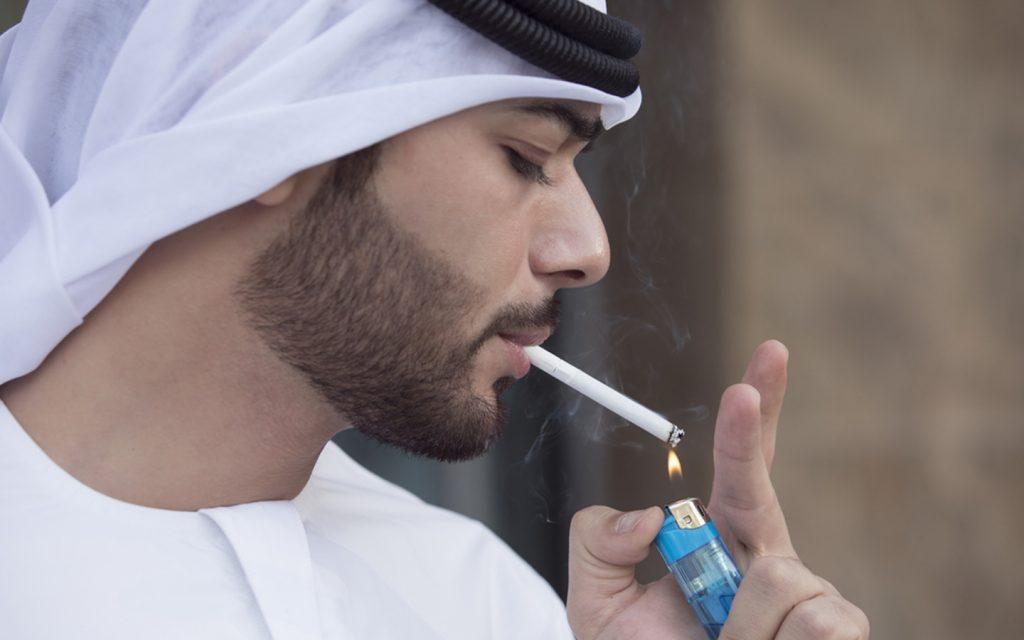Emirati lighting a cigarette