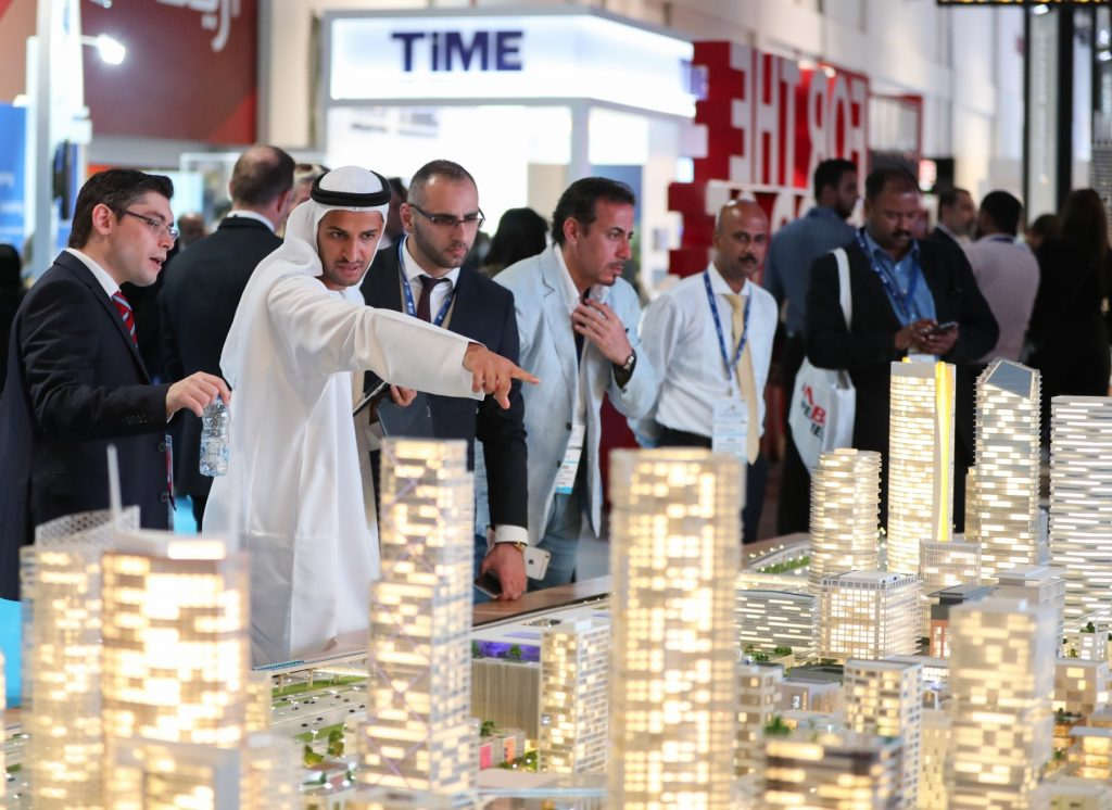 A shot from last year's Cityscape Global Dubai at the World Trade Centre showing an Emirati man and a group of businessmen standing next to a large model of a development