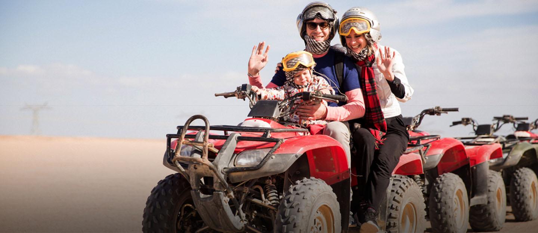 Family riding a dune buggy in Dubai