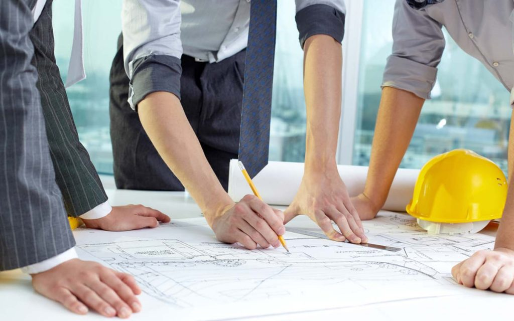 Engineers looking at a construction plan for a project