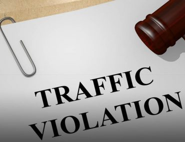 Image of an application to contest a traffic fine and a gavel