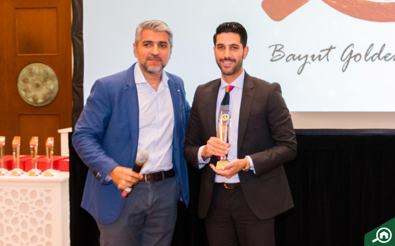 Core Savills, Dubai receiving the Golden Circle award at the Bayut Iftar