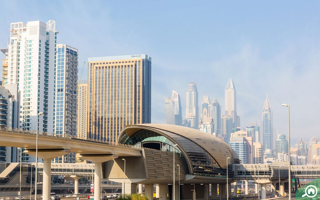 View of DMCC Metro Station with Dubai Marina in the background