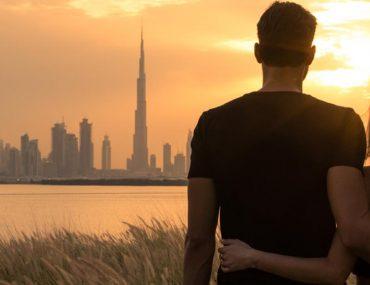 Couple on a honeymoon in Dubai watching the sun go down over the Dubai skyline 16.01.2020