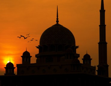 The Sheikh Zayed Mosque Silhouette against sunset backdrop