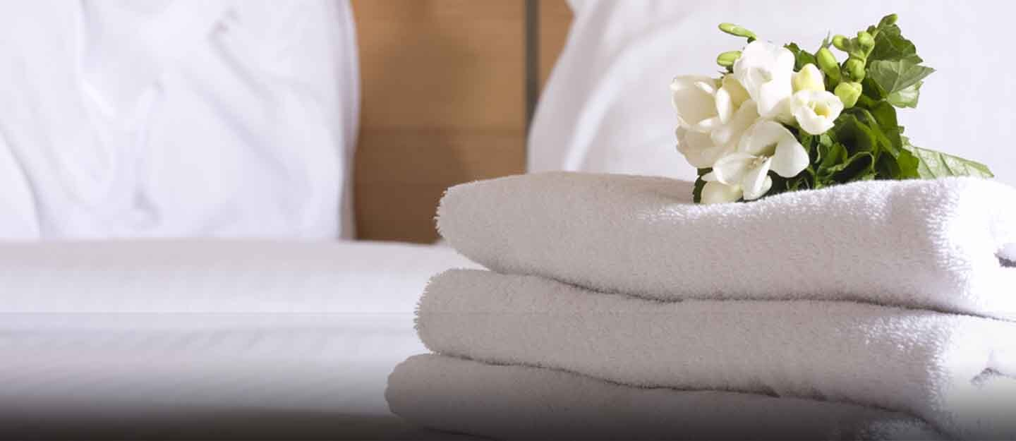 Hotel room with towels on the bed
