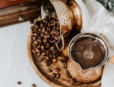 Coffee beans and brewed Arabic coffee