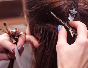 woman getting hair extensions