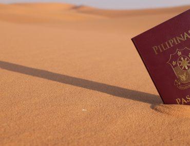Philippines Passport against the backdrop of the UAE desert