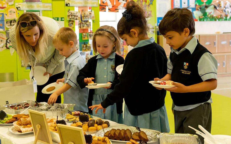 Students enjoying food at a party at Cranleigh School