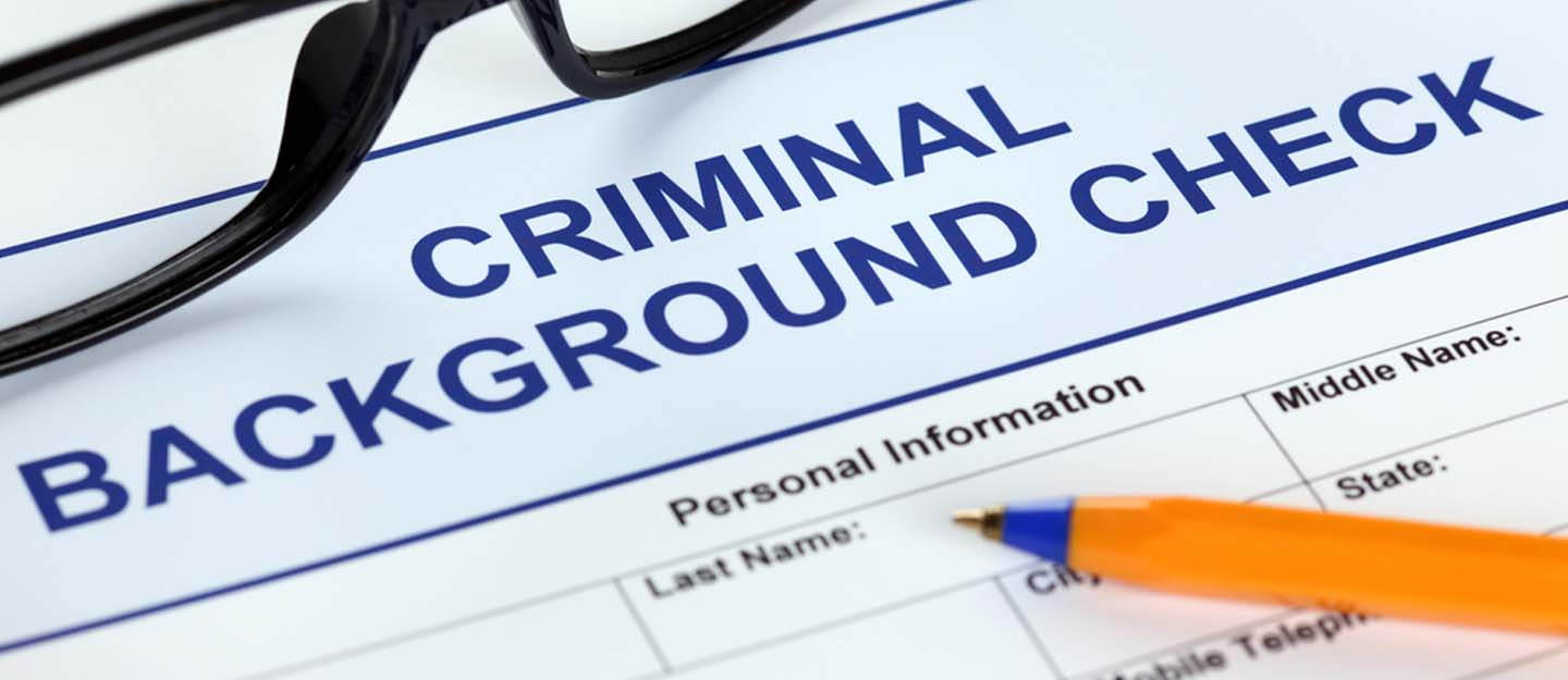 A Criminal background check form and a pen
