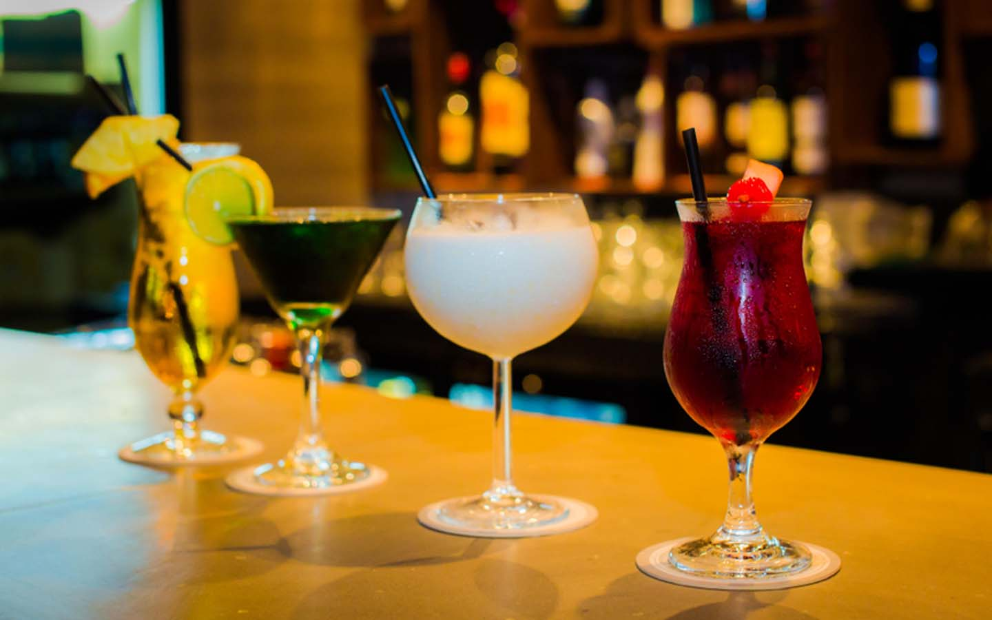 Different types of alcoholic cocktails at a bar