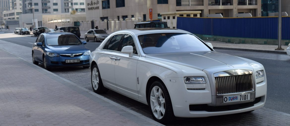 A Rolls Royce parked in the shade