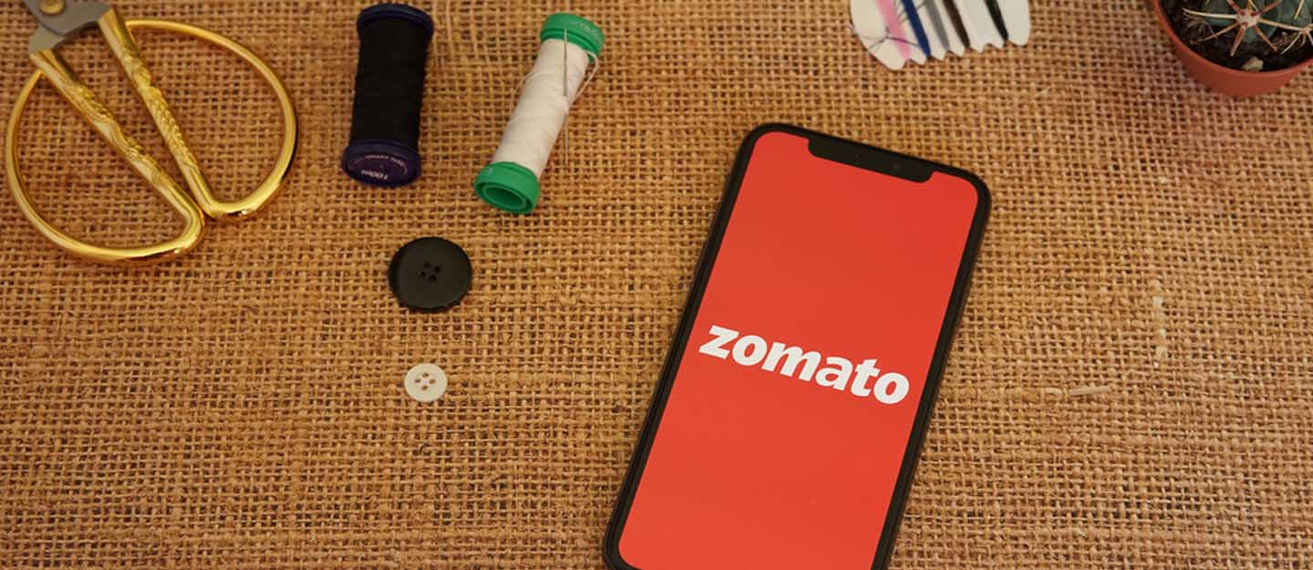 Zomato app and a few accessories placed on a table