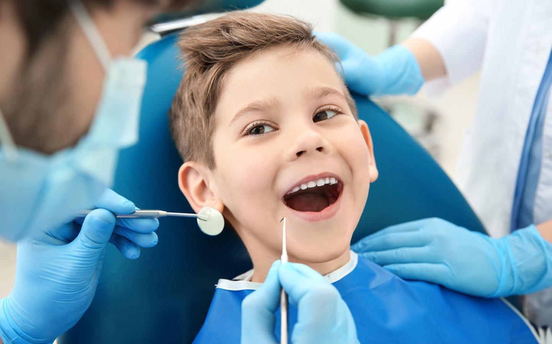 Dentist treating child