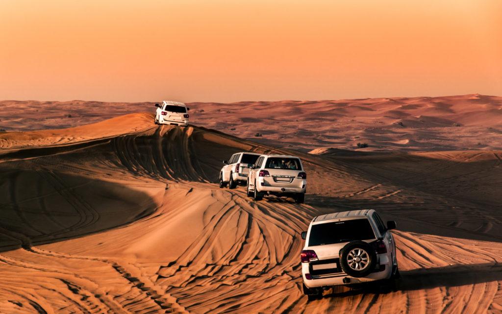 Land cruisers dune bashing