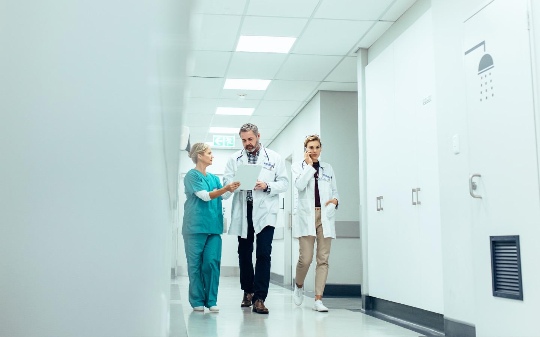 Doctor & nurse discuss a medical report