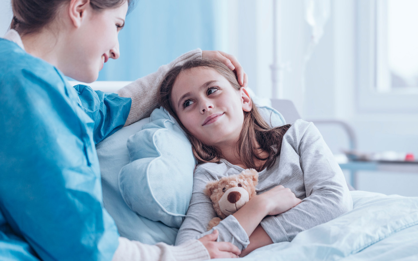 Doctor talking to child under her care