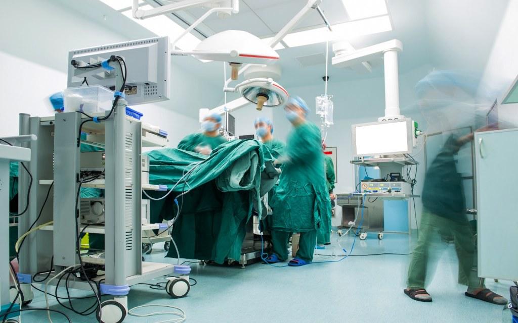 Doctors operating patients