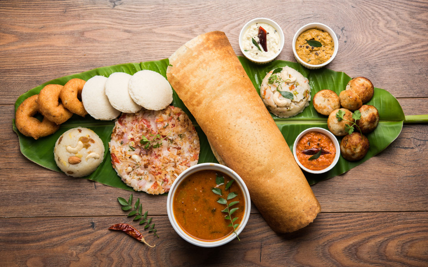 Dosa with curries and sambhar