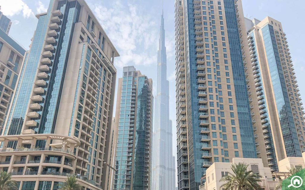 View of apartment buildings in Downtown Dubai, with Burj Khalifa in the background