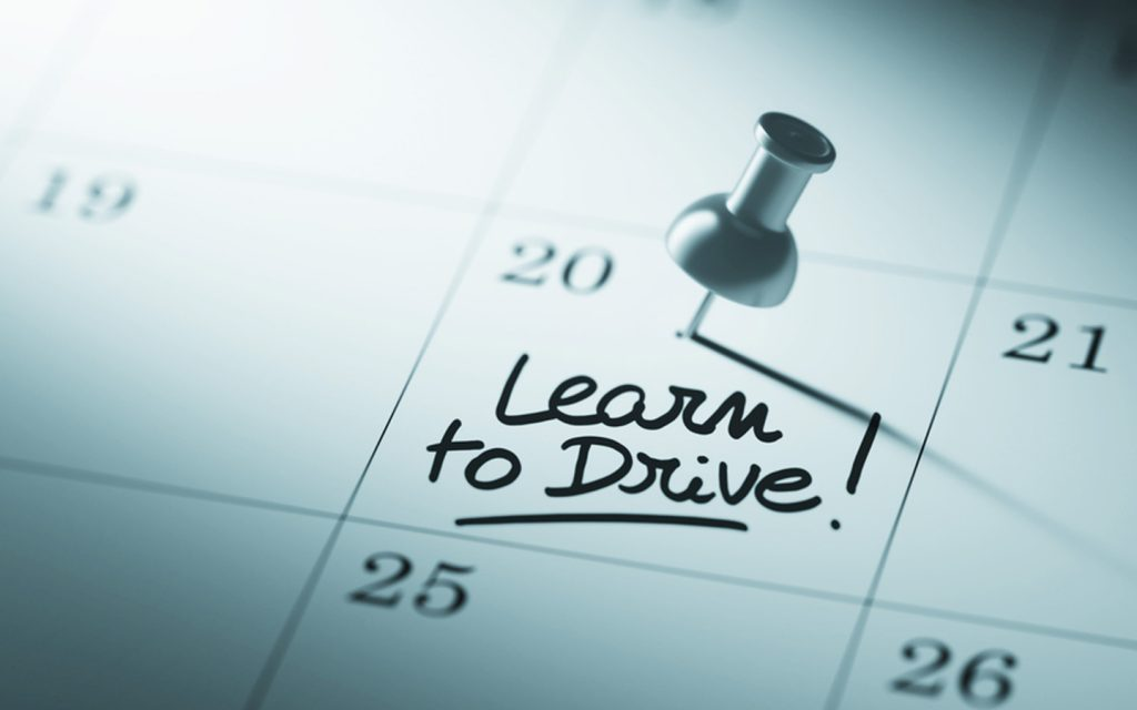 A calendar marked with a text stating learn to drive.