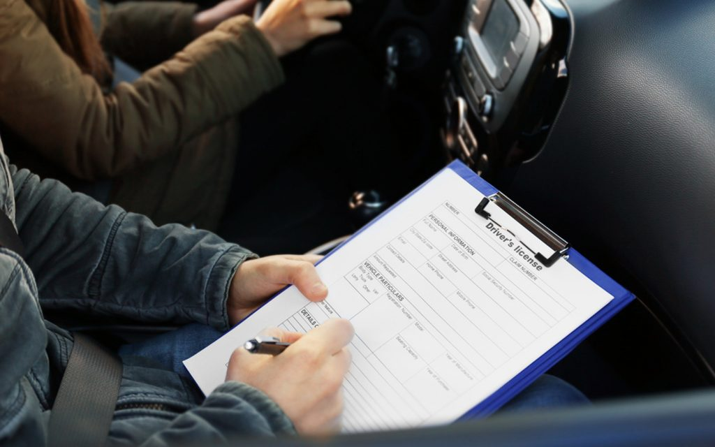 A person filling out the driving license form.