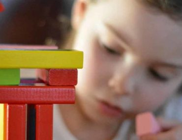 Kid with toys Dubai Early Childhood Development Centre