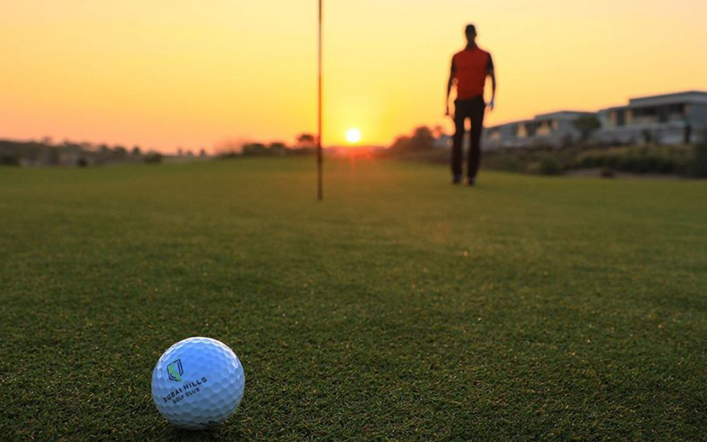 An image capturing a sunny view of the Dubai Hills Golf  Club.