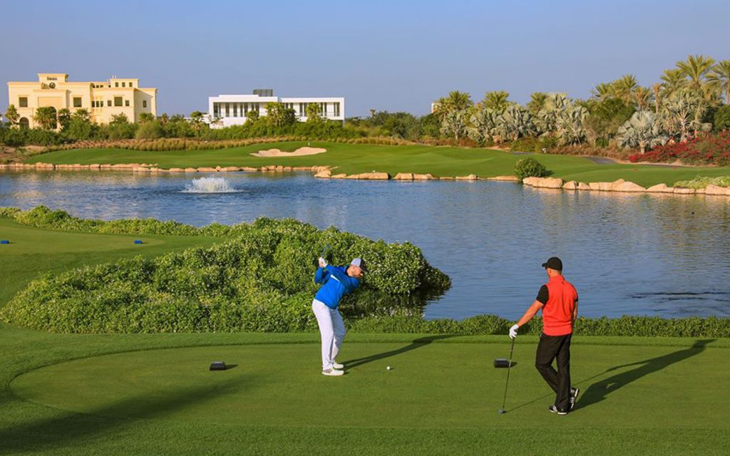 A golfer is hitting a shot while the other is watching.  (Image credits: Dubai Hills Golf Club Facebook Page)