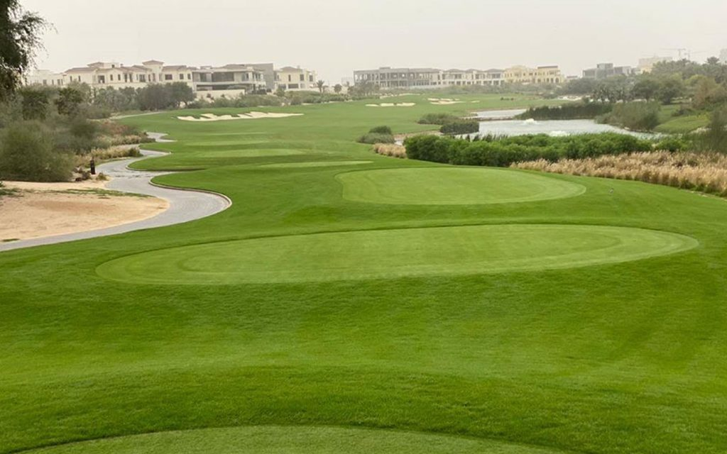 A picture capturing the green fairway of Dubai Hills Golf Club.